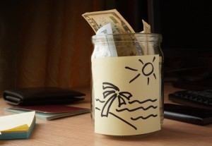 jar of money for travelling on the table.  travel concept.