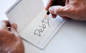 Avoiding Debt: 4 Tips to Help You Live within Your Means